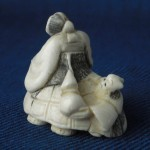 "Netsuke ""2 men on a turtle"""
